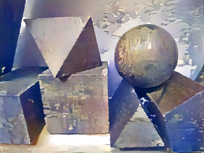 Shows a close up of a 'still life' painting by Grant of a series of geometric wood shapes first used in a Birmingham architect's drawing office in 1930's